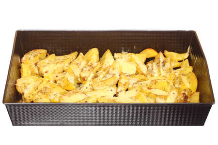 Roasted potatoes with spices and cheese in tray white background photo