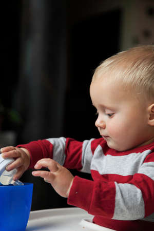 baby boy playing with bottle and mug drinking indoor Stock Photo - 17786922