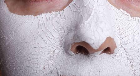 mud woman: Mature woman with facial Mask. Spa
