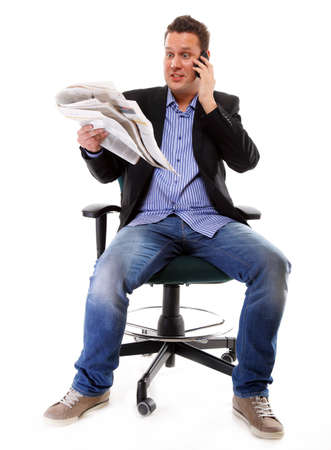 A man looks surprised, shocked while reading a newspaper speek phone white background photo