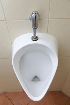 White porcelain urinal, pissoir in public toilets Stock Photo - 17874641