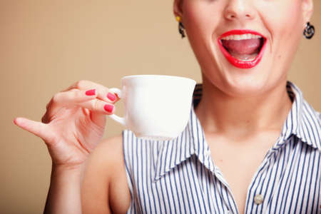 Beautiful Girl Drinking Tea or Coffee. Cup of Hot Beverage brown background Stock Photo - 17874876