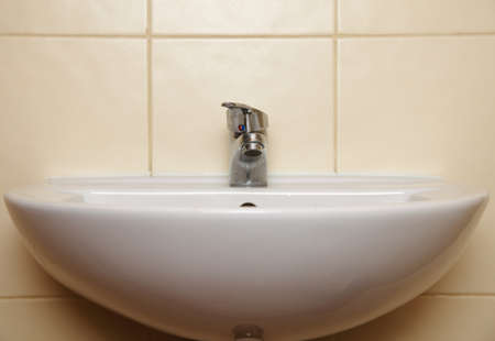 White sink and tap in the bathroom public toilet Stock Photo - 17874872