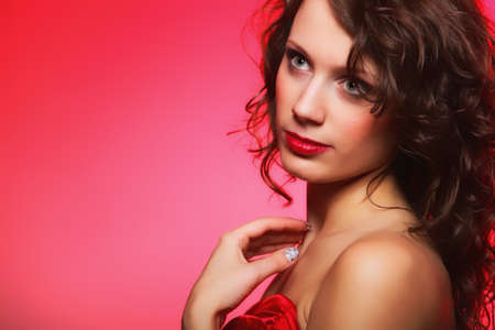 Beautiful young fashion woman with makeup on red background Stock Photo - 17874981