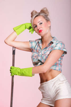 Cheerful pin up girl retro style portrait pinup Woman housewife cleaner mop pink background photo