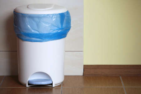 trash can with a plastic bag inside indoor Stock Photo - 18154864