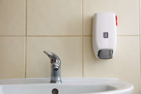 White sink tap and liquid soap in the bathroom Stock Photo - 18154959