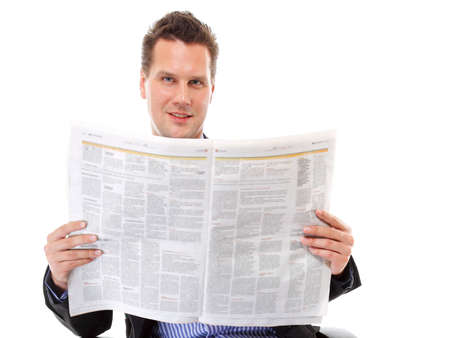 learning to read: Businessman reading a newspaper isolated