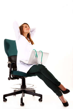 Female doctor working on her laptop stretching at her workplace against a white background Stock Photo - 18339305