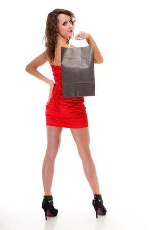 Happy cheerful full length. Shopping sexy young woman with gift bag on white background