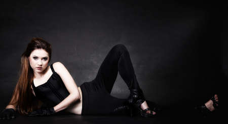 subculture: Subculture - full length beauty punk girl studio shot black background