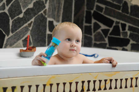 little two years old baby boy taking a bath playing with soap bubbles Stock Photo - 18551241