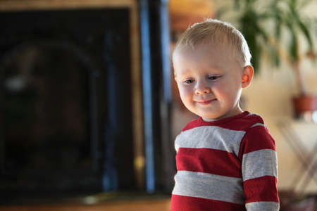 Closeup portrait of cheerful little boy smiling indoor Stock Photo - 18567873