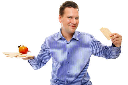 Man eating healthy in her diet, having a crispbread and apple studio shot white background photo