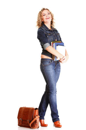 Beautiful young woman blonde 20s standing full body in jeans shoulder bag isolated on white background Caucasian girl photo