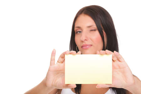 Gift card. Excited woman showing empty blank paper card sign female model isolated Stock Photo - 18654596