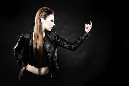 subculture: Subculture beauty punk girl in leather jacket black background