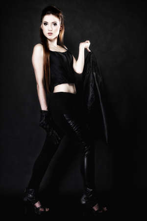Subculture - full length beauty punk girl with leather jacket black background photo