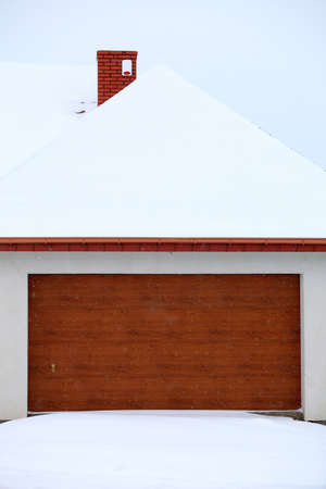 car garage door surrounded by snow, winter time Stock Photo - 18727165