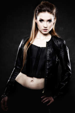 Subculture beauty punk girl in leather jacket black background photo