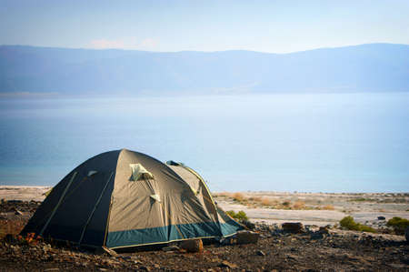 camping tent: Camping tent in the nature. Mountains and lake.