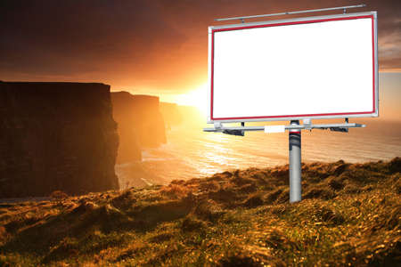 Blank white billboard over evening sky for your advertisement. Famous cliffs of Moher at sunset in Co. Clare Ireland. photo