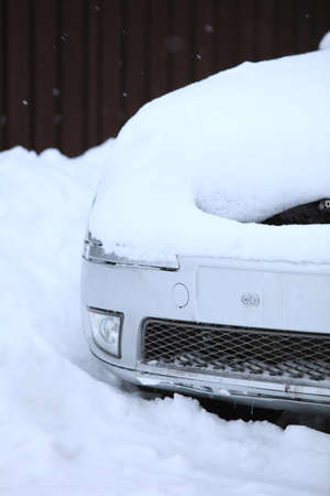 a car covered in snow photo