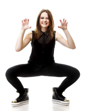 Grimacing. Full length young angry woman making silly face on white background photo