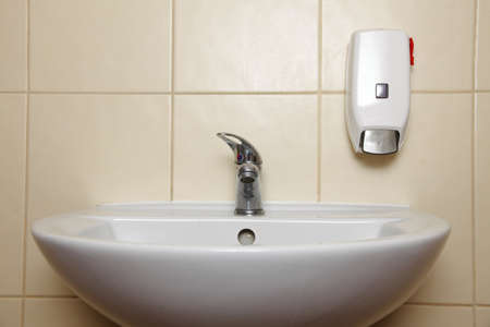 White sink tap and liquid soap in the bathroom Stock Photo - 19008440