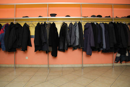 Locker room many clothes in cloakroom in business centre photo