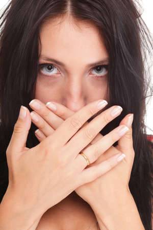 Young woman covering her mouth with both hands isolated over white background photo