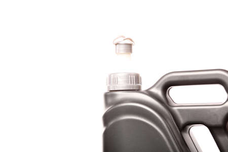 Closeup gray canister with car engine oil white background photo