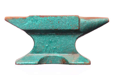 Old rusty heavy steel green anvil  isolated on white background photo