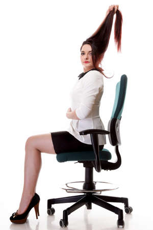 mmc: Portrait of a beautiful brunette young business woman sitting on chair white background