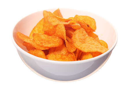 Potato paprika chips in bowl. Isolated on white background photo