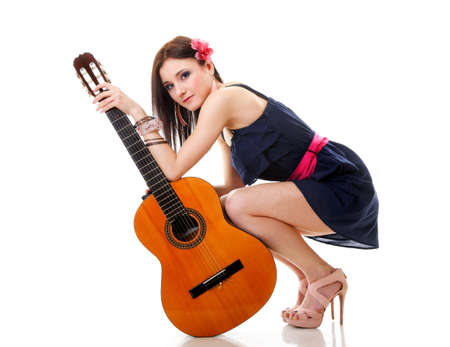 Music lover, full length summer girl with guitar isolated on white background photo
