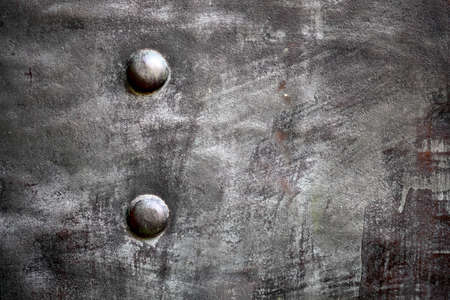 Black grunge metal plate or armour texture with rivets as background Stock Photo - 19134558