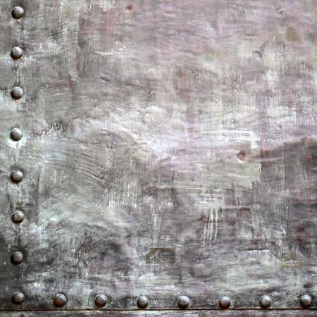 Black grunge metal plate or armour texture with rivets as background Stock Photo - 19134569