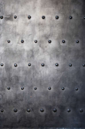 Black grunge metal plate or armour texture with rivets as background Stock Photo - 19134550