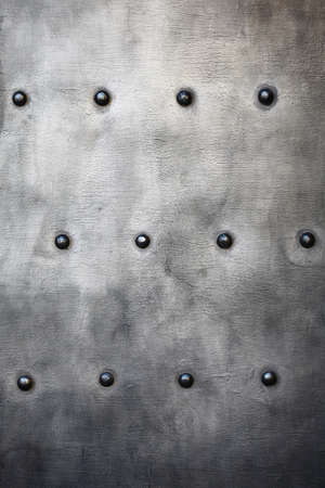 Black grunge metal plate or armour texture with rivets as background Stock Photo - 19134552