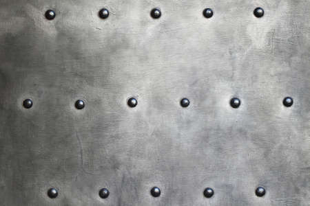 Black grunge metal plate or armour texture with rivets as background Stock Photo - 19134571