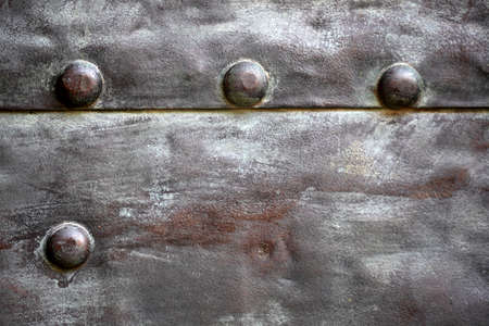 Black grunge metal plate or armour texture with rivets as background Stock Photo - 19219986