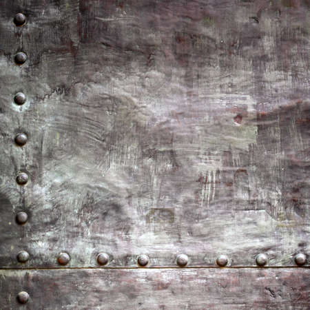 Black grunge metal plate or armour texture with rivets as background Stock Photo - 19219979