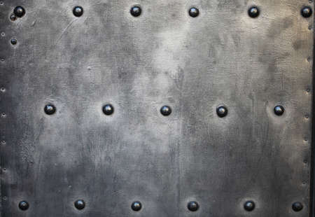 Black grunge metal plate or armour texture with rivets as background Stock Photo - 19219984