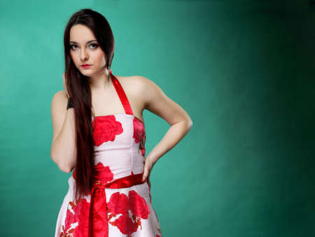 mmc: young woman in summer flowery dress on green background fashion photo