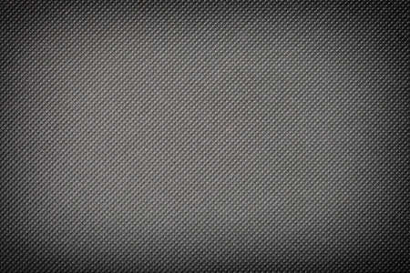 perforated gray textile pattern texture background or backdrop photo
