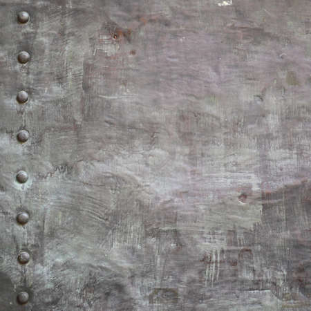 Black grunge metal plate or armour texture with rivets as background Stock Photo - 19282478