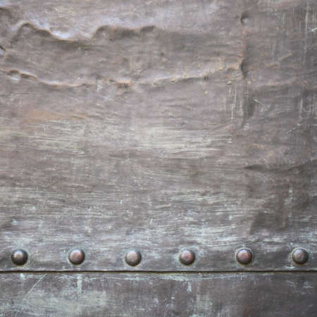 Black grunge metal plate or armour texture with rivets as background Stock Photo - 19282543