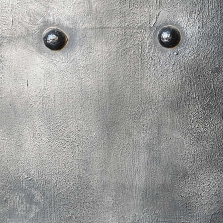 Black grunge metal plate or armour texture with rivets as background Stock Photo - 19282559