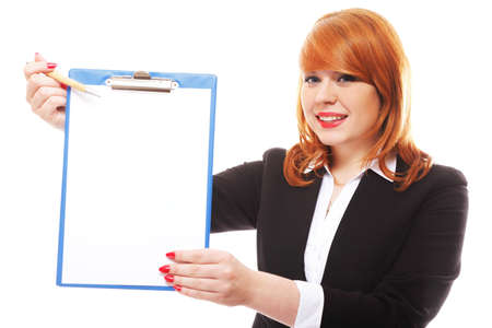 Redhaired businesswoman holds clipboard with blank and points with pen. Isolated on white background photo